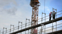 Construction site with crane and workers Stock Footage