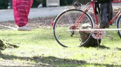 Woman walking on rope with man and bicycle in background and camera is showing Stock Footage