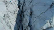 Stock Video Footage of Aerial view of moraine covered deep crevasses Knik Glacier  Alaska, USA