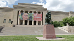 Statue in front of William Rockhill Nelson Gallery of Art Stock Footage