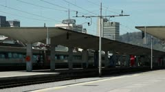 Train driving pass trainstation in Ljubljana Stock Footage