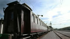 Train wagon waiting on a railway sation on a suny day Stock Footage