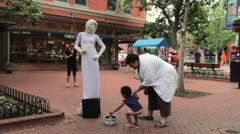 Statue woman street performer in Boulder Stock Footage