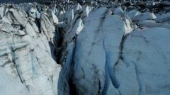 Stock Video Footage of Aerial view of moraine covered deep crevasses Knik Glacier  Alaska, USA