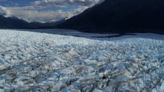 Aerial view of moraine covered Knik Glacier, Alaska, USA Stock Footage