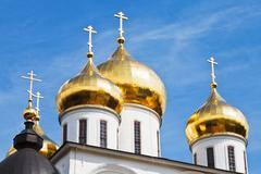 Golden cupola of russian church Stock Photos