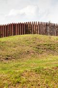 Wall from wooden stakes on rampart Stock Photos