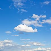 White clouds in blue sky in summer day Stock Photos