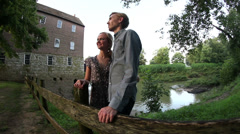 Slider shot of attractive couple at old mill. Stock Footage