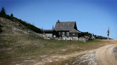 Shot of the traditional cottage from the chair lift on Velika Planina-Slovenia Stock Footage