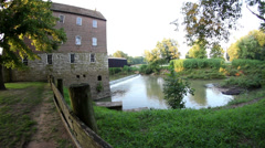 Slider shot of old historic mill Stock Footage