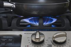 Close up of skillet on gas stove Stock Photos