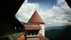 Shot of one part of Bled`s castle including tower and balcony Stock Footage
