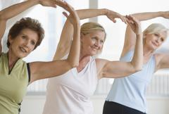 Senior women doing yoga - stock photo