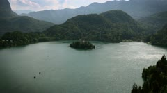 Panoramic shot of lake Bled with the famous island in the midlle of it with the Stock Footage