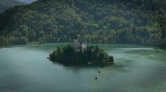 Shot of an island with church on lake Bled in Slovenia Stock Footage