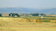 Stock Video Footage of Traffic on a farm road and distant Colorado mountains