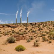 Smokestacks of power plant on Navajo reservation in Arizona - stock photo