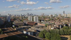 Time-lapse of passenger trains passing Vauxhall between 5-10pm Stock Footage