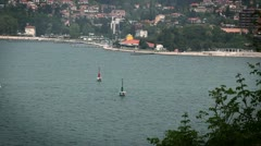 Sailing boat comming to the port between red and green marker Stock Footage
