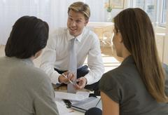 Couple meeting with financial advisor - stock photo