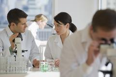Scientists working in pharmaceutical laboratory Stock Photos