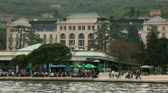 Restaurand on riviera of Portorose and old hotel in  the back Stock Footage