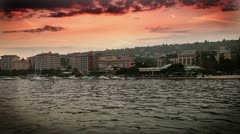 sunset in Portorose with added time laps of clouds - stock footage