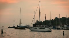 Sailing boats docked at the port in Portorose during the sunset Stock Footage