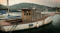 Old fishing boat docked in the harbour Stock Footage