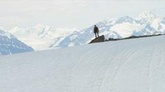 Aerial view of triumphant climber remote wilderness,  Alaska, USA - stock footage