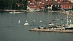Isola port with some boats comming in and out Stock Footage