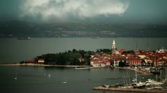Isola's port on the cloudy day with some sailing boats coming in Stock Footage