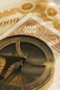 Antique compass and corporate bonds Stock Photos