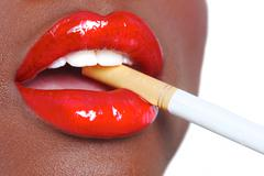 beautiful lips of a woman with a cigarette - stock photo