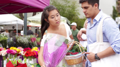 Young Couple Choosing Flowers at Farmers Market Stock Footage