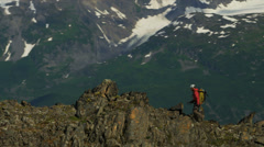 Aerial view male mountain climber ridge walking, Alaska, USA Stock Footage
