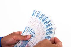 Hands holding turkish lira banknotes Stock Photos