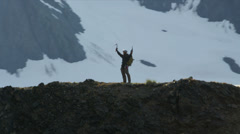 Aerial view of triumphant climber remote wilderness,  Alaska, USA Stock Footage