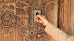 Key opens door to 12th century stave church Stock Footage