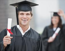 Stock Photo of A graduate holding a diploma