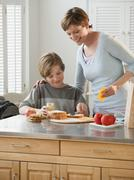 Mother and child preparing food - stock photo