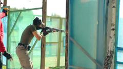 Man opens the door and shoot at targets Stock Footage