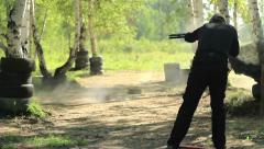 Man shoots at targets on the shooting competition of weapons Stock Footage