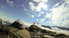 Helicopter and triumphant climber in remote wilderness Alaska, USA Stock Footage