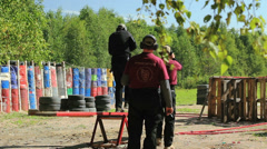 Man passes an obstacle course and shooting at targets Stock Footage