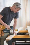 Male carpenter working Stock Photos