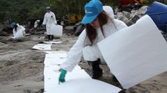 OIL SPILL FEMALE WORKERS VOLUNTEERS BIOHAZARD HAZMAT Stock Footage
