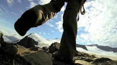 Mountain climber wearing equipment ridge walking, Alaska, USA Stock Footage