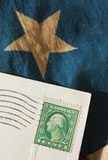 Postcard on American flag Stock Photos